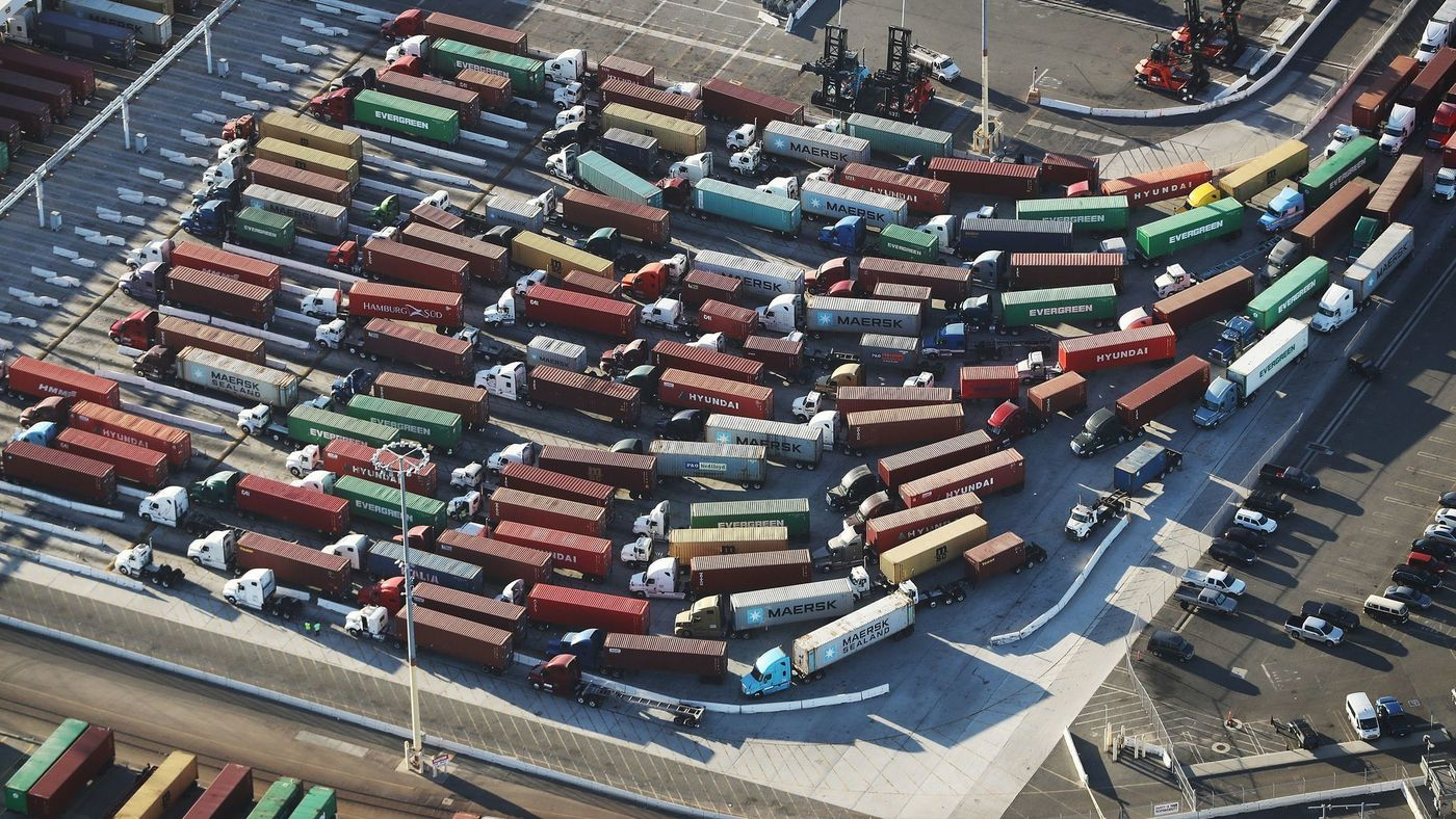 Trucks with shipping containers at the Port of Los Angeles