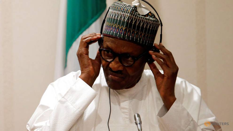 nigeria-s-president-muhammadu-buhari-adjusts-his-translation-device-during-a-news-conference-at-the-presidential-villa-in-abuja-1