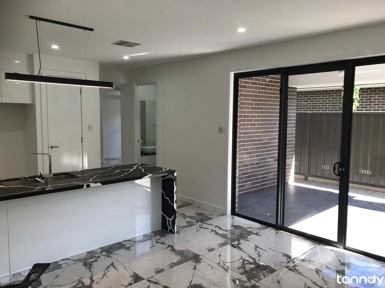 Entrance area with black marble tiles
