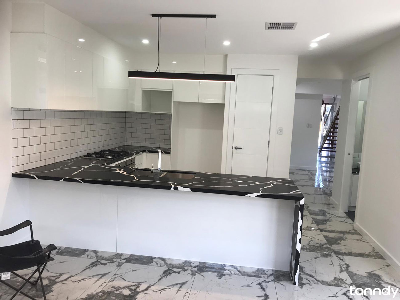L shape kitchen cabinet with black marble countertop